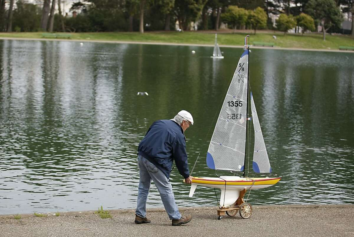 On October 5, 2012 in San Francisco Calif. at Golden Gate Park, Michael Fischer, the San Francisco Model Yacht Club's free sail squadron officer, prepares to set the Wind Horse to sail on Spreckles Lake.