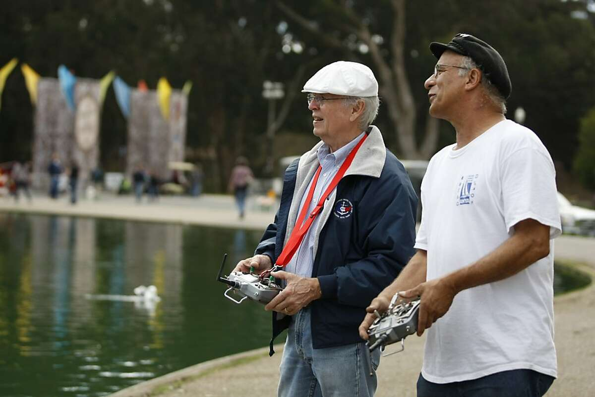 On October 5, 2012 in San Francisco Calif. at Golden Gate Park, Michael Fischer (left) and Rich Styles, both squadron officers of the San Francisco Model Yacht Club, discuss the conditions of Spreckles Lakes Friday morning as they sail their boats.