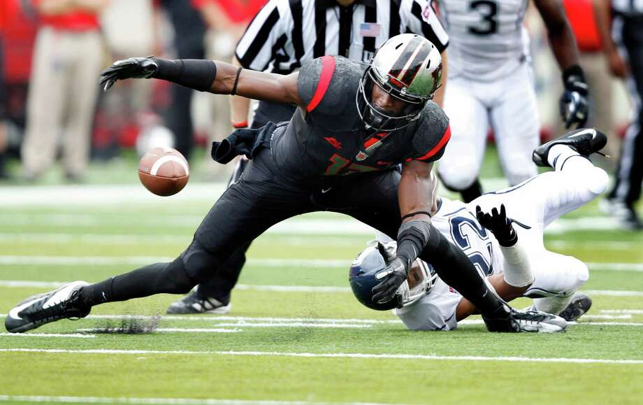 Rutgers wide receiver Brandon Coleman can't hold onto the ball as Connecticut safety Andrew Adams (22) tries to make a tackle during the second half of an NCAA college football game in Piscataway, N.J., Saturday, Oct. 6, 2012. Rutgers won 19-3. (AP Photo/Mel Evans) Photo: Mel Evans, Associated Press / AP