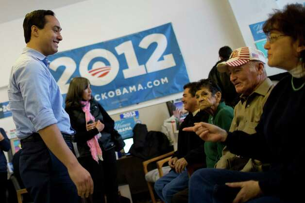 Texas state Rep. Joaquín Castro talks with volunteers before addressesing the crowd at the Obama for America West office in Denver, Saturday, Oct. 6, 2012, before the group begins canvasing the streets to register people to vote in the Nov. 6 general election. Photo: Justin Edmonds, For The Express-News / © 2012 Justin Edmonds