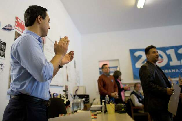 Texas state Rep. Joaquín Castro applauds Denver City Councilman Paul Lopez while giving remarks to a crowd of volunteers at the Obama for America West office in Denver, Saturday, Oct. 6, 2012. Photo: Justin Edmonds, For The Express-News / © 2012 Justin Edmonds