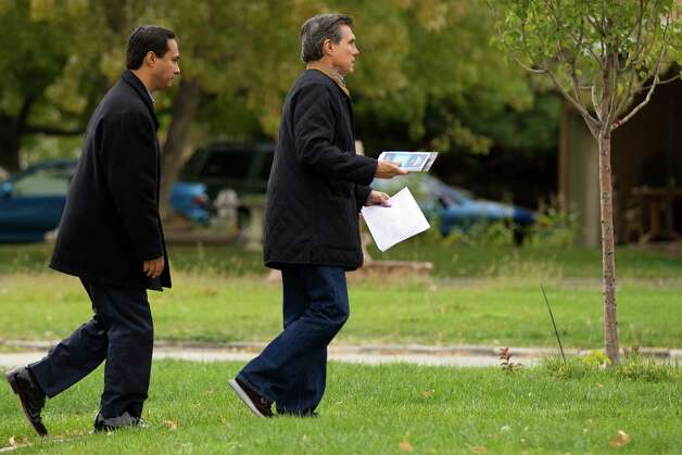 Texas state Rep. Joaquín Castro (left) canvases the Athmar Park neighborhood with Federico Peña (right), former Secretary of Transportation and former mayor of Denver, looking to register people to vote in the Nov. 6 general election in Denver on Saturday, Oct. 6, 2012. Photo: Justin Edmonds, For The Express-News / © 2012 Justin Edmonds