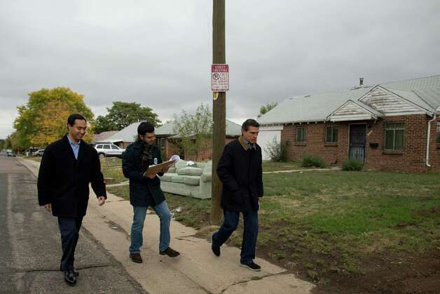 Texas state Rep. Joaquín Castro (left), canvases the Athmar Park neighborhood with Federico Peña (right), former Secretary of Transportation and former mayor of Denver, looking to register people to vote in the Nov. 6 general election in Denver on Saturday, Oct. 6, 2012. Photo: Justin Edmonds, For The Express-News / © 2012 Justin Edmonds