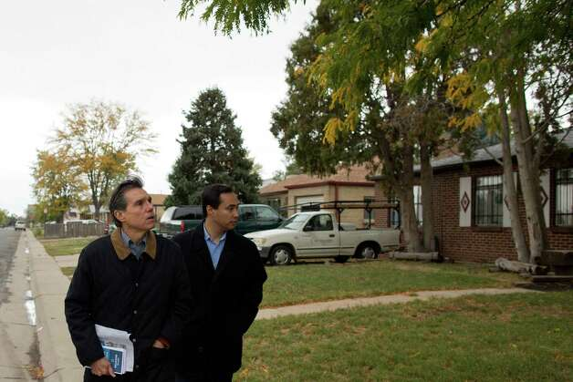 Texas state Rep. Joaquín Castro (right) canvases the Athmar Park neighborhood with Federico Peña, former Secretary of Transportation and former mayor of Denver, looking to register people to vote in the Nov. 6 general election in Denver on Saturday, Oct. 6, 2012. Photo: Justin Edmonds, For The Express-News / © 2012 Justin Edmonds