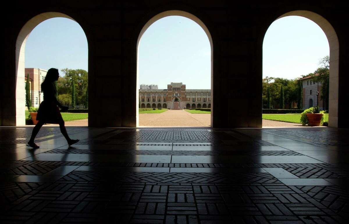 A student walks past the archways in front of the Fondren Library at Rice University Tuesday, Oct. 2, 2012, in Houston. Rice celebrates its 100th anniversary this year. Seen across the quad through the center arch is Lovett Hall.
