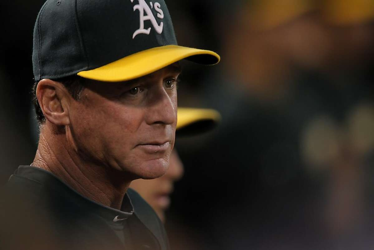 A's manager, Bob Melvin, watches the game against the Rangers from the dugout. The Oakland Athletics clinched a playoff spot on Monday, October 1, 2012, after they defeated the Texas Rangers at O.co Coliseum in Oakland, Calif.