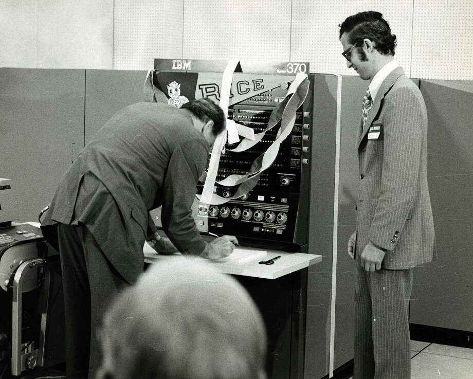 Rice University president Dr. Norman Hackerman ceremoniously switches on a new computer system as Dr. M. Stuart Lynn of the Rice Institure for Computer Services and Applications looks on.  The system will be responsible for tabulating county-wide presidential election returns in November for Election Central. Photo taken August of 1972. Photo: Houston Chronicle File Photo