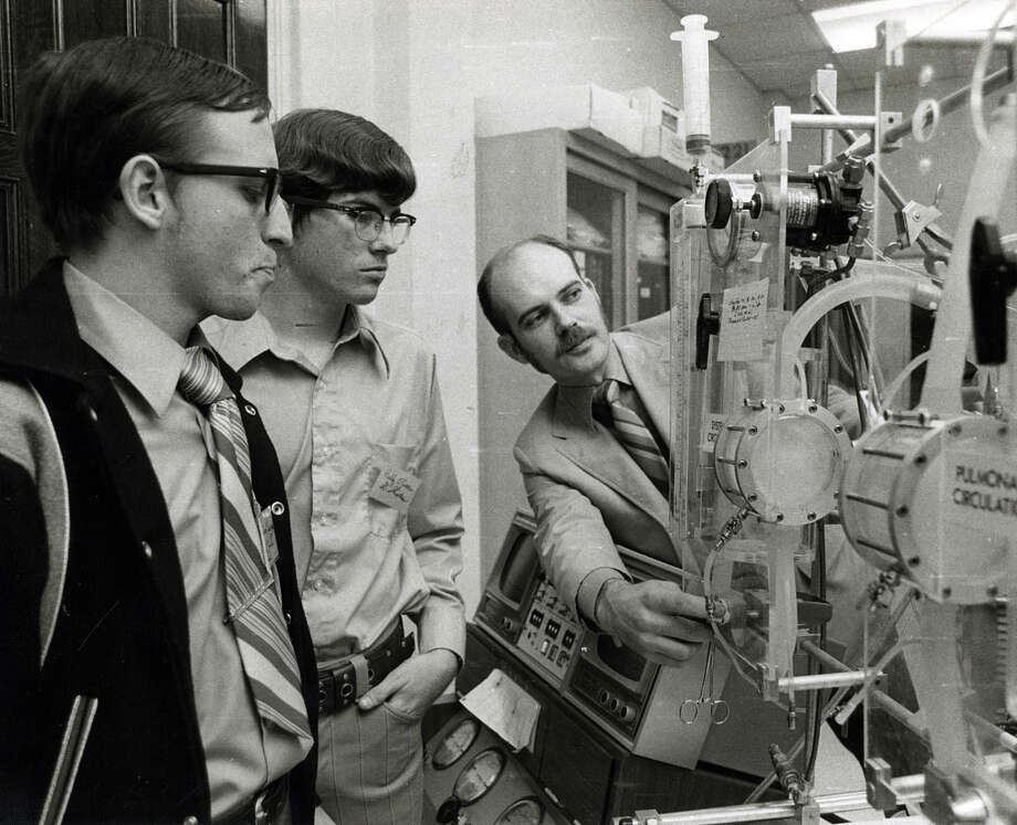 Vincent Kupczzynski, left, and Paddy O'Connor listen as Dr. William Spargo explains the workings of equipment in an enginering laborary at Rice University. The two high school students were attending Rice's Engineering majors Day at the school in January of 1972. Photo: Houston Chronicle File Photo