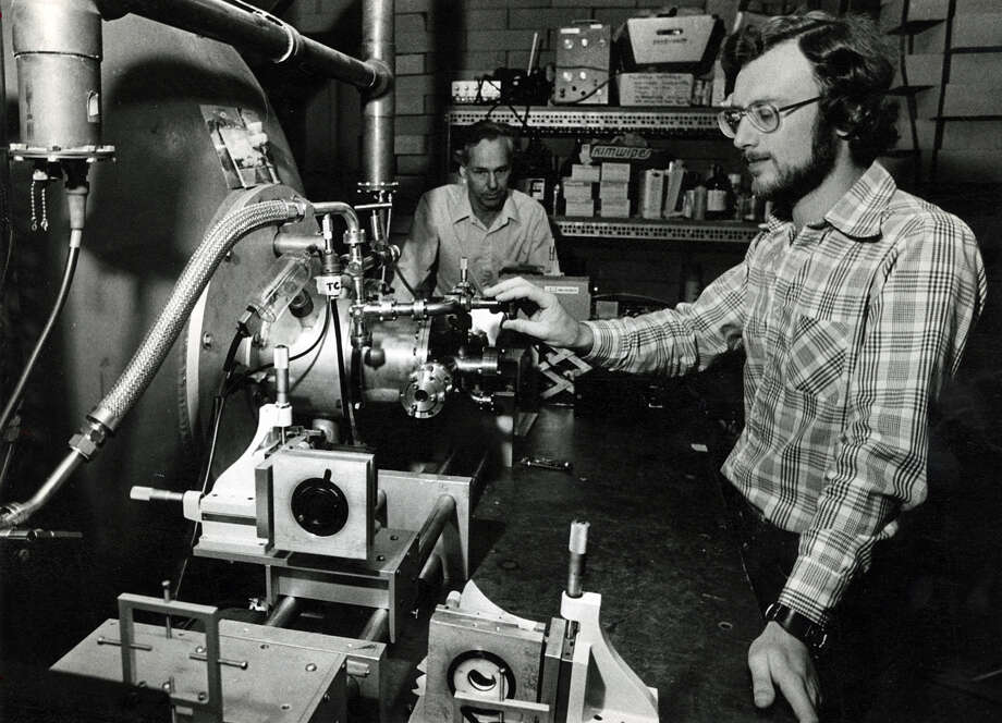 Frank Tittle, left, and and Wolfgang Ernst look at an electron beam chamber at Rice University in April of 1979. Photo: Houston Chronicle File Photo