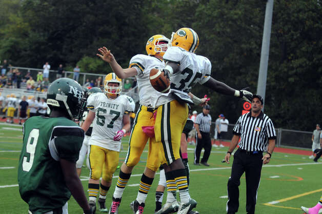 Trinity's Sean Brown, right, celebrates his touchdown with Dan O'Leary as Norwalk High School hosts Trinity Catholic in a football game in Norwalk, Conn., Oct. 6, 2012. Photo: Keelin Daly / Stamford Advocate