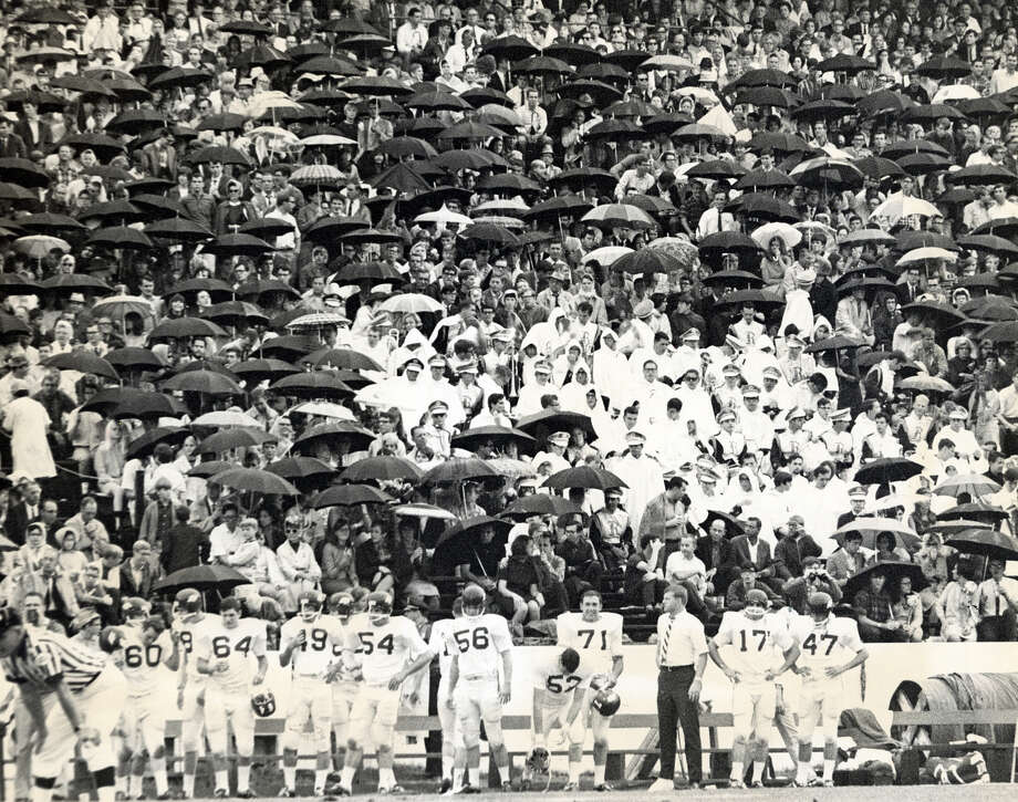 The stadium crowd was well protected from the rain, but Rice's offense wasn't as they lost to the Arkansas Razorbacks in this November 1967 photo. Photo: Jim Cox, Houston Chronicle / Houston Post files