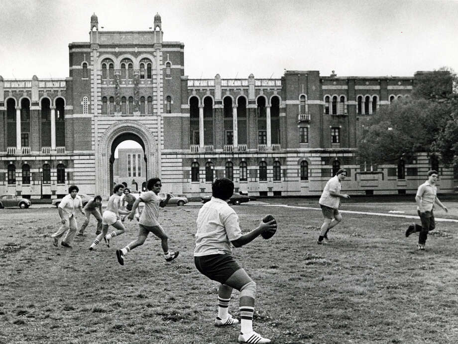With spring finally here, students find football on a Sunday afternoon more captivation than the halls of learning. At Rice University, Pedro Alfaro, center, prepares to fling the pigskin in a pick-up game on the east lawn by Lovett Hall in April of 1979. Photo: Houston Chronicle File Photo