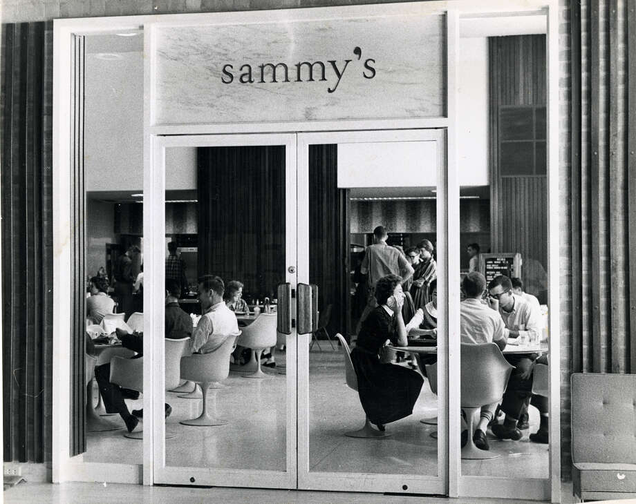 Cafeteria-style lunch and snacks are served to Rice students in Sammy's snack bar. Sammy's is one of the many reasons there is heavy traffic to the Memorial Center. Before the center was built, eating facilities were in the library basement. Photographed in November 1959. Photo: Houston Chronicle File Photo