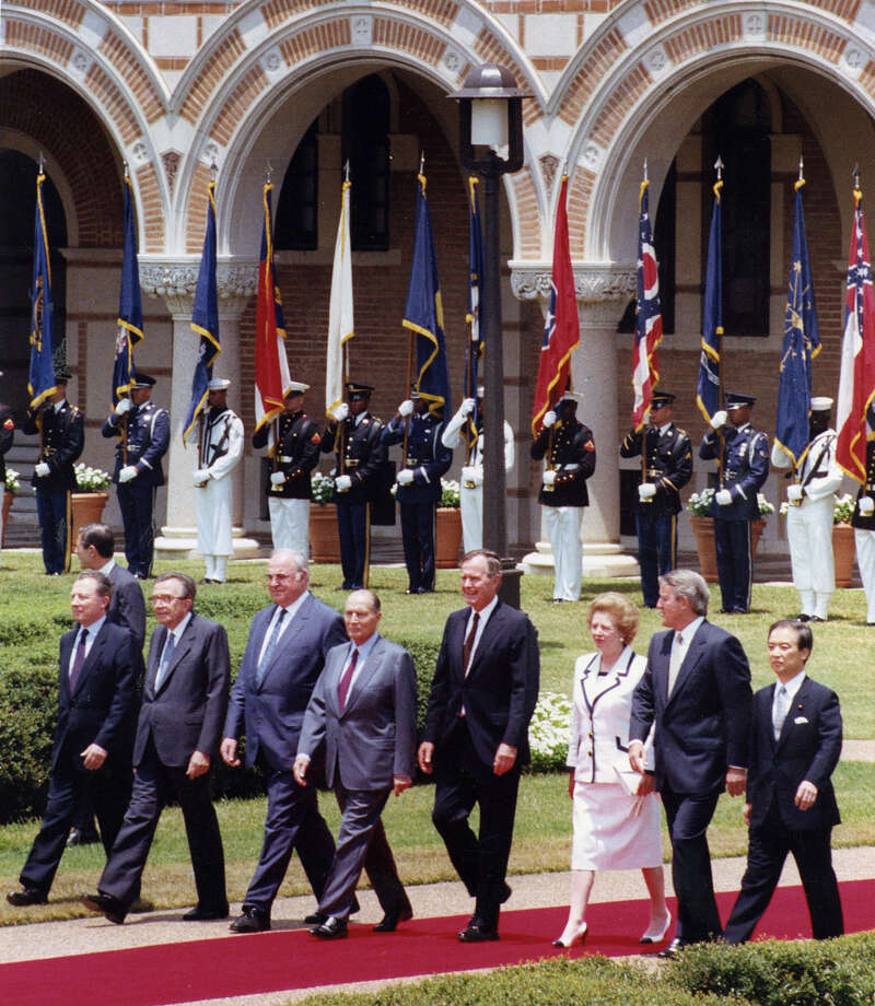 Jacques Delors, left, Guilio Andreotti, Helmut Kohl, Francois Mitterand, George Bush, Margaret Thatcher, Brian Mulroney, and Toshiki Kaifu during the Economic Summit at Rice University on July 9, 1990. Photo: Ira Strickstein, Houston Chronicle / Houston Post files