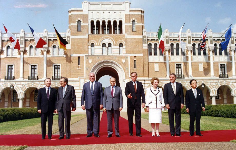 Leaders in the Economic Summit line up for the class photo at Rice following the day's meetings. From left, EC President Delors, Itallian Prime Minister Andreotti, West German Chancellor Kohl, French President Mitterand, US President Bush, British Prime Minister Mulroney, and Japanese Prime Minister Kaifu.  Photo taken July, 9, 1990. Photo: Nuri Vallbona, Houston Chronicle / Houston Post files