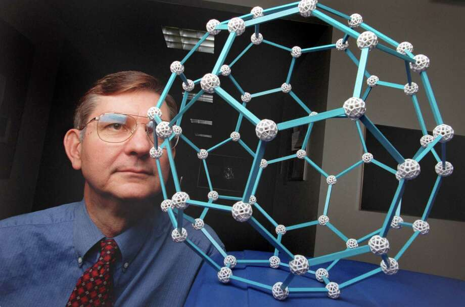 Lon Wilson, a chemist at Rice University, with a model of a C60 molecule. Buckyballs (a colloquial term for buckminsterfullerene, a roughly spherical molecule consisting of 60 carbon atoms) are now thought to be useful in medical treatments. Photo taken November 26, 2000. Photo: D. Fahleson, Houston Chronicle / Houston Chronicle