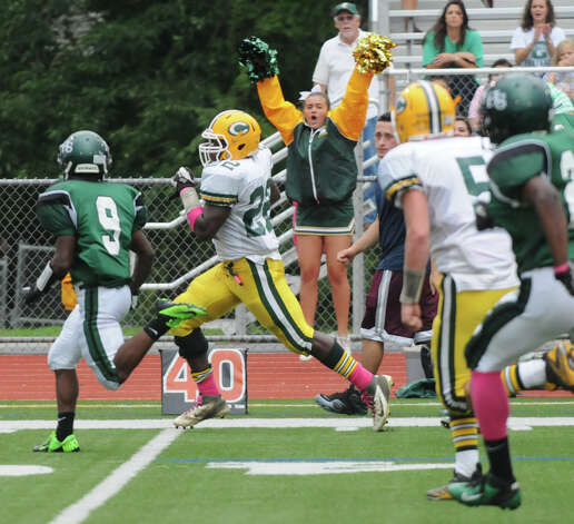 Trinity's Shaquan Howsie heads for the end zone as Norwalk High School hosts Trinity Catholic in a football game in Norwalk, Conn., Oct. 6, 2012. Photo: Keelin Daly / Stamford Advocate