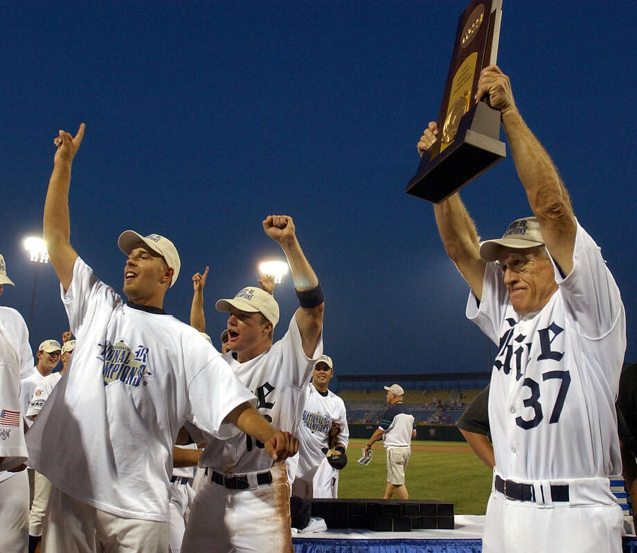 Wayne Graham holds up the trophy after the game  during the Rice-Stanford Championship game 3, at the College World Series in Rosenblatt Stadium, in Omaha, Nebraska. Rice won the championship game 14-2, giving the school it's first national title. Photo: Karen Warren, HOUSTON CHRONICLE / HOUSTON CHRONICLE