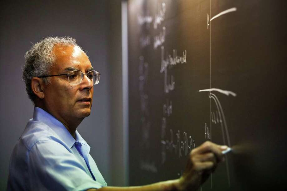 Raymond Johnson, the first African-American to earn a degree at Rice University in 1968, teaches a differential equations class to math students at Rice Friday, Sept. 11, 2009, in Houston.  Johnson had been accepted as a graduate student at Rice in 1963 when two alumni sued the school, seeking to enforce provisions in the original charter creating the school which noted that it was to educate white students. Rice trustees ultimately won the lawsuit and Johnson was enrolled, earning a PhD in math. Photo: Michael Paulsen, Houston Chronicle / Houston Chronicle