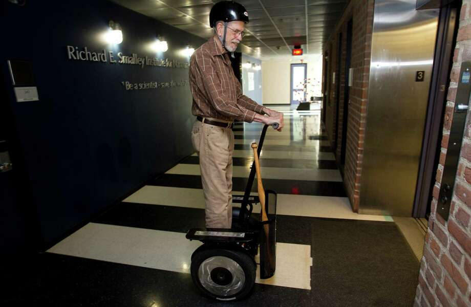 Dr. Robert Hauge, distinguished faculty fellow in chemistry, rides a Segway into the elevator at the Richard E. Smalley Institute for Nanoscale Science and Technology on his way to a meeting at Rice University Tuesday, Oct. 2, 2012, in Houston. Photo: Brett Coomer, Houston Chronicle / © 2012 Houston Chronicle