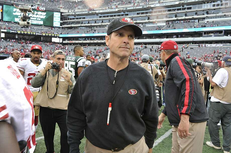 San Francisco 49ers head coach Jim Harbaugh leaves the field after an NFL football game against the New York Jets Sunday, Sept. 30, 2012, in East Rutherford, N.J. the 49ers won the game 34-0. (AP Photo/Bill Kostroun) Photo: Bill Kostroun, Associated Press