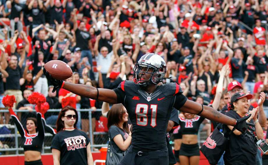 PISCATAWAY, NJ - OCTOBER 6: Wide receiver Mark Harrison #81 of the Rutgers Scarlet Knights reacts after scoring a touchdown against the Connecticut Huskies in the first half as during a game at High Point Solutions Stadium on October 6, 2012 in Piscataway, New Jersey. Rutgers defeated Connecticut 19-3. (Photo by Rich Schultz /Getty Images) Photo: Rich Schultz, Getty Images / 2012 Getty Images