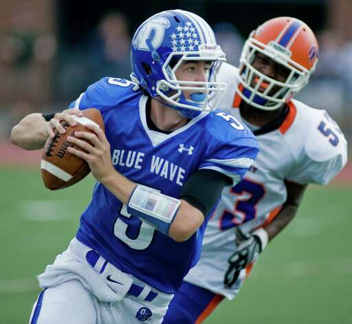 Darien High School quarterback Henry Baldwin looks for a receiver during a football game against Darien High School, played at Darien. Saturday, Oct. 6, 2012 Photo: Scott Mullin / The News-Times Freelance