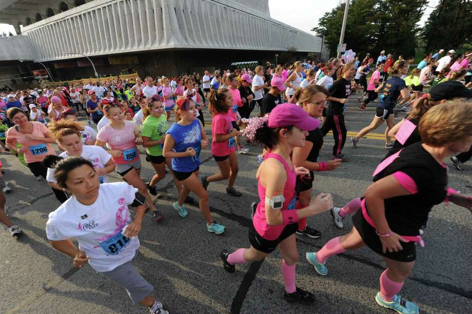 Runners break from the starting line during the 18th Annual Susan G. Komen Northeastern New York Race for the Cure in Albany, N.Y. Saturday Oct. 6, 2012. (Michael P. Farrell/Times Union) Photo: Michael P. Farrell
