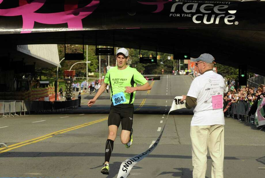 Alex Paley of Alban,y with a time of 15:55, wins the 18th Annual Susan G. Komen Northeastern New York Race for the Cure in Albany, N.Y., Saturday Oct. 6, 2012. (Michael P. Farrell/Times Union) Photo: Michael P. Farrell
