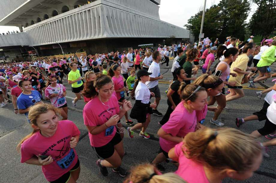 Runners break from the starting line during the 18th Annual Susan G. Komen Northeastern New York Race for the Cure in Albany, N.Y., Saturday Oct. 6, 2012. (Michael P. Farrell/Times Union) Photo: Michael P. Farrell