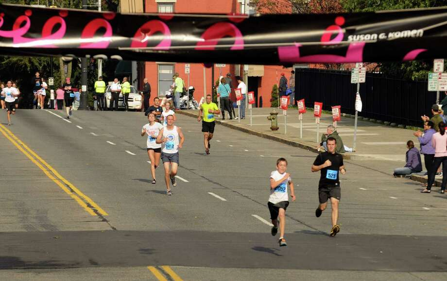 Runners head to the finish line during the 18th Annual Susan G. Komen Northeastern New York Race for the Cure in Albany, N.Y., Saturday Oct. 6, 2012. (Michael P. Farrell/Times Union) Photo: Michael P. Farrell