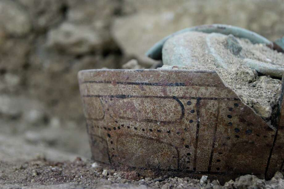 This ceramic pot was among a trove of artifacts found in a burial chamber at the  El Peru-Waka archaeological site in Guatemala's Laguna del Tigre National Park. / El Peru-Waka'  Archaeological Pr