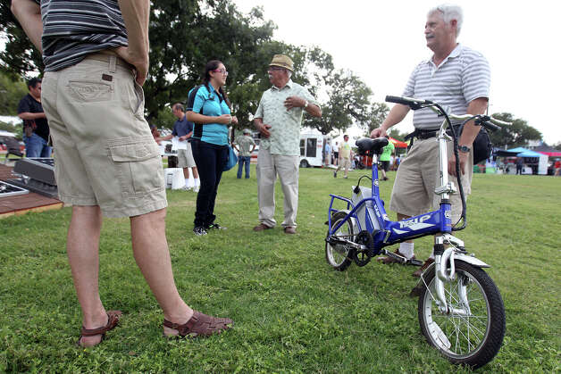 Charles Schneider of Pleasanton shows off his folding electric bicycle during Solar Fest San Antonio at  Lion's Field on Saturday, Oct. 6, 2012. Photo: Jennifer Whitney, For The Express-News / © Jennifer Whitney