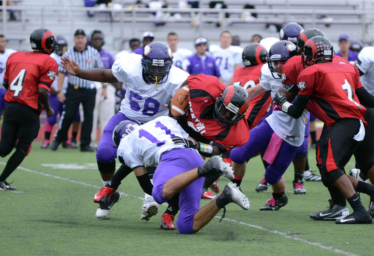 Westhill'sNick Jimenez (11) takes down Central's Anderson Cherilus (22) during the football game at Westhill High School on Saturday, Oct. 6, 2012.