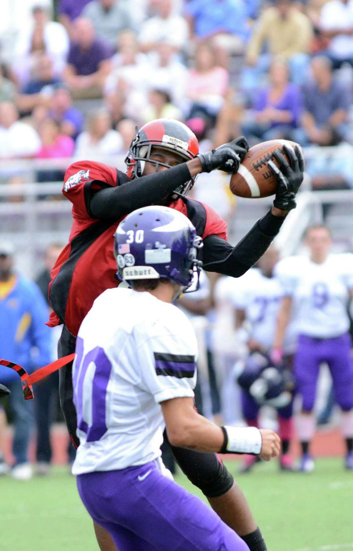 Central's Keyshaun Thomas (1) hauls in an interception intended for Westhill's Kyle Cruz (30) during the football game at Westhill High School on Saturday, Oct. 6, 2012.