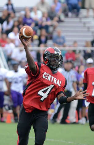Central's Brandon Turner (4) throws a pass during the football game against Westhill at Westhill High School on Saturday, Oct. 6, 2012. Photo: Amy Mortensen / Connecticut Post Freelance