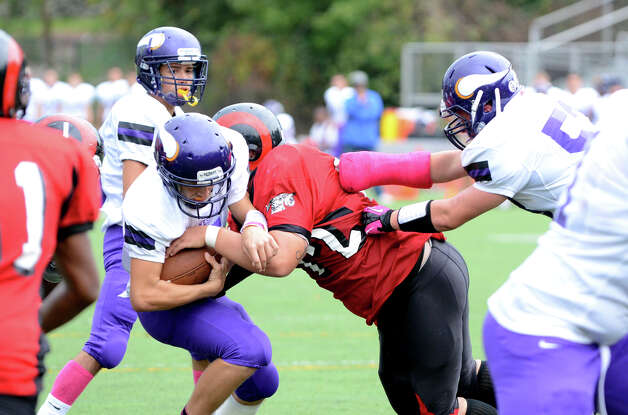 Westhill's Ryan Cappola (5) carries the ball as Central's Kevin Contreras (72) defends during the football game at Westhill High School on Saturday, Oct. 6, 2012. Photo: Amy Mortensen / Connecticut Post Freelance