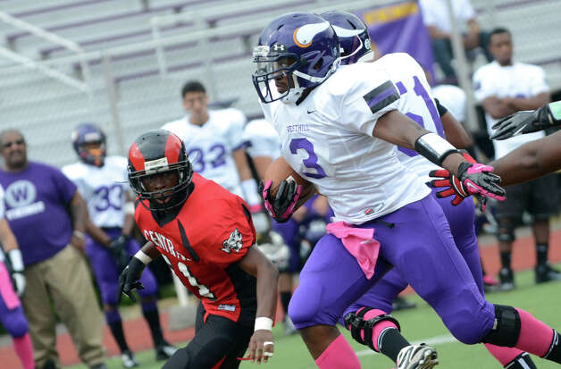 Westhill's Moise Francillon (3) carries the ball during the football game against Central at Westhill High School on Saturday, Oct. 6, 2012. Photo: Amy Mortensen / Connecticut Post Freelance