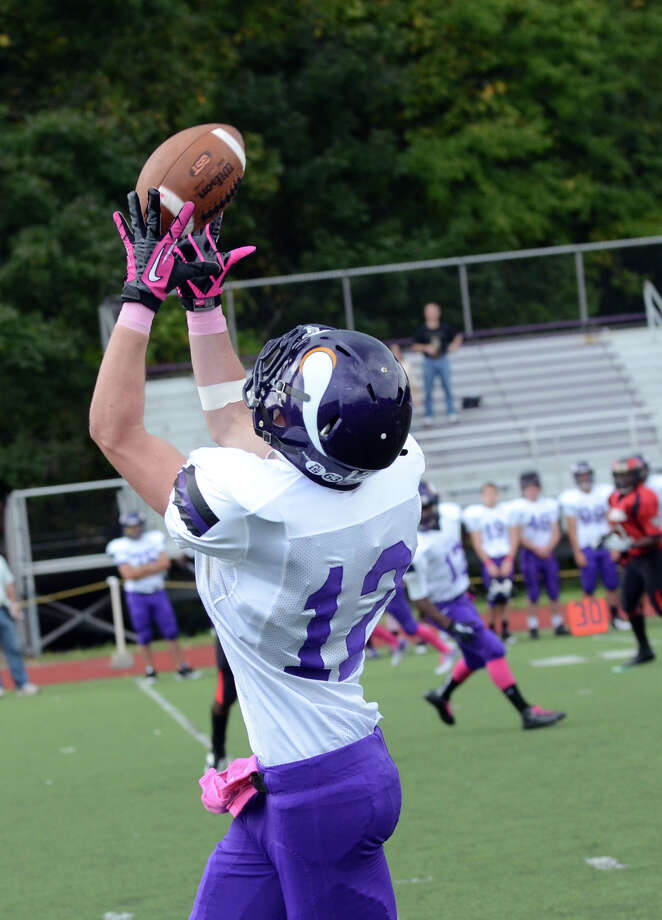 Westhill's Nick Sinatra (12) hauls in a pass during the football game against Central at Westhill High School on Saturday, Oct. 6, 2012. Photo: Amy Mortensen / Connecticut Post Freelance
