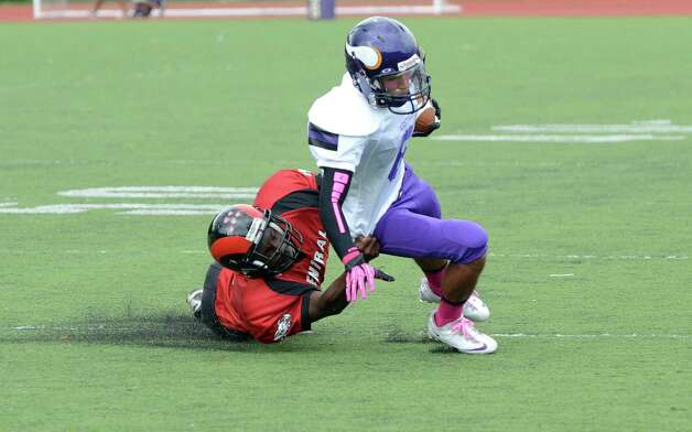 Central's Dequan Crawford (4) brings down Westhill's Randy Barahona (6) during the football game at Westhill High School on Saturday, Oct. 6, 2012. Photo: Amy Mortensen / Connecticut Post Freelance