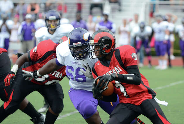 Central's Keyshaun Thomas (1) carries the ball as Westhill's Ronnie Griggs (68) defends during the football game at Westhill High School on Saturday, Oct. 6, 2012. Photo: Amy Mortensen / Connecticut Post Freelance