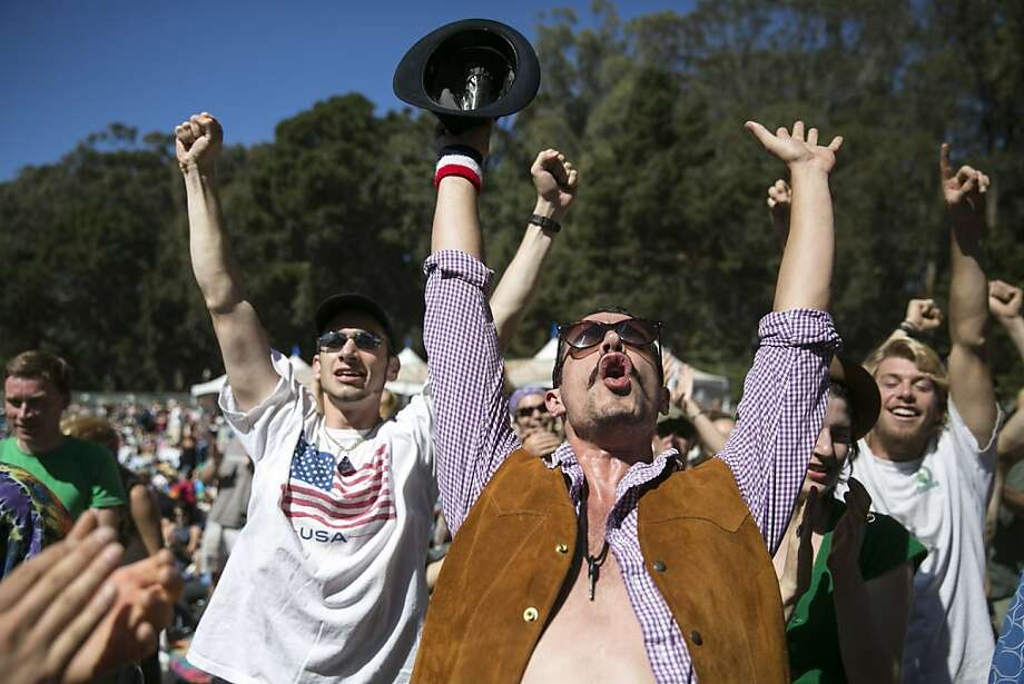 William Marcelino (left) and Andre Lesale cheer for the Alison Brown Quartet at the Banjo Stage during Hardly Strictly Bluegrass in Golden Gate Park in San Francisco, Calf., on Saturday, October 6, 2012. Photo: Laura Morton, Special To The Chronicle