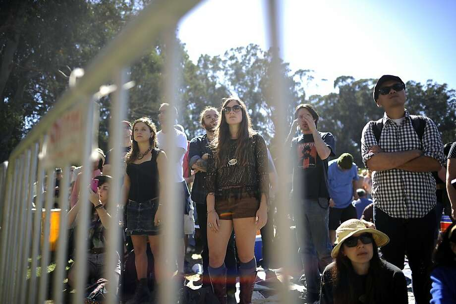 Crowds are seen behind barricades as they listen to Justin Townes Earl play.  Hardly Strictly Bluegrass festival in Golden Gate Park in San Francisco, CA Friday October 6th, 2012. Photo: Michael Short, Special To The Chronicle