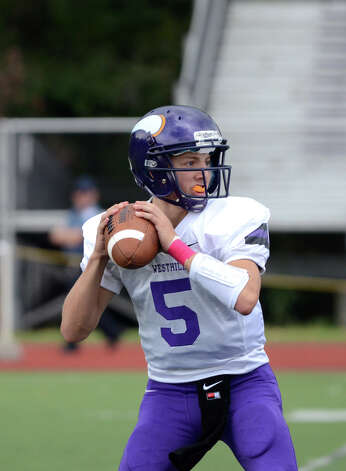 Westhill's Ryan Cappola (5) looks to throw a pass during the football game against Central at Westhill High School on Saturday, Oct. 6, 2012. Photo: Amy Mortensen / Connecticut Post Freelance