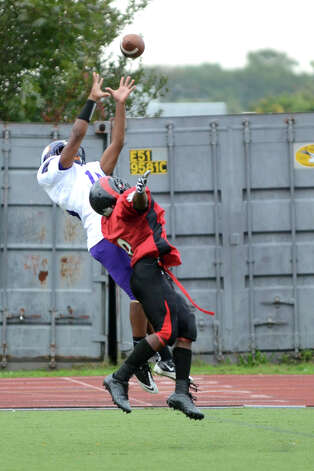 Westhill's Yveson Cassamajor (15) hauls in a pass for a touchdown during the football game against Central at Westhill High School on Saturday, Oct. 6, 2012. Photo: Amy Mortensen / Connecticut Post Freelance