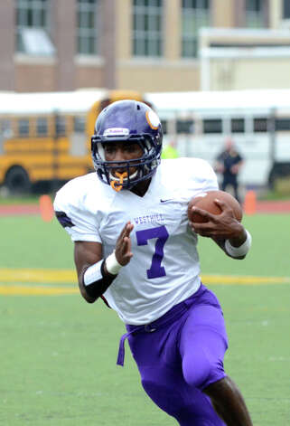Westhill's Davell Cotterell (7) carries the ball during the football game against Central at Westhill High School on Saturday, Oct. 6, 2012. Photo: Amy Mortensen / Connecticut Post Freelance
