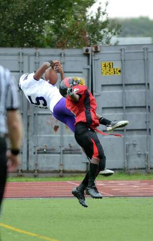 Westhill's Yveson Cassamajor (15) hauls in a pass during the football game against Central at Westhill High School on Saturday, Oct. 6, 2012. Photo: Amy Mortensen / Connecticut Post Freelance