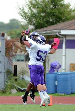 Westhill's Yveson Cassamajor (15) celebrates a touchdown with teammate Chris Soule (53) during the football game against Central at Westhill High School on Saturday, Oct. 6, 2012. Photo: Amy Mortensen / Connecticut Post Freelance
