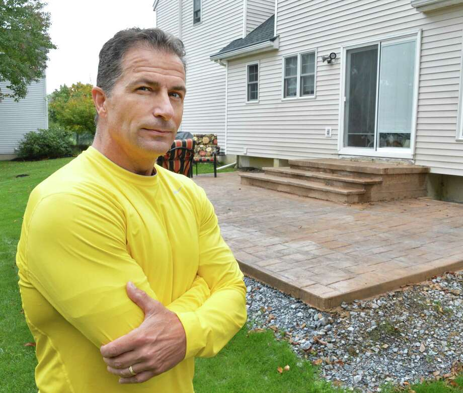 Ray Smith next to the badly constructed cement patio at his Colonie home Wednesday, Oct. 3, 2012.  (John Carl D'Annibale / Times Union) Photo: John Carl D'Annibale / 00019520A