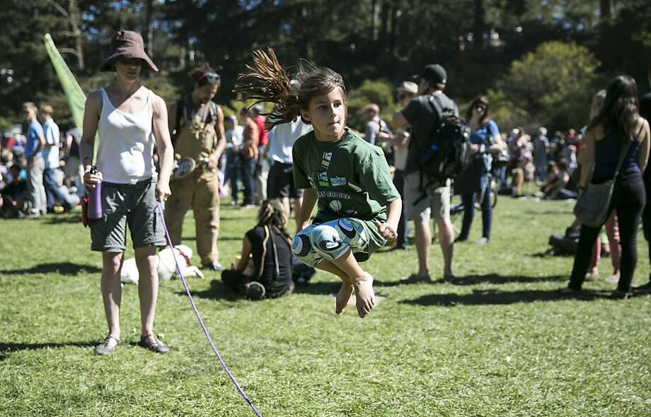 Cecilia Lanir, age 7, jumps rope with the help of Heather World (left) during Hardly Strictly Bluegrass in Golden Gate Park in San Francisco, Calf., on Saturday, October 6, 2012. Photo: Laura Morton, Special To The Chronicle